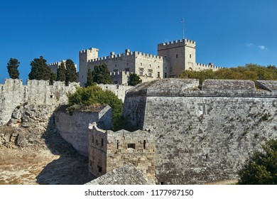 The moat and turrets of the medieval castle of the Joannite Order in the city of Rhodes