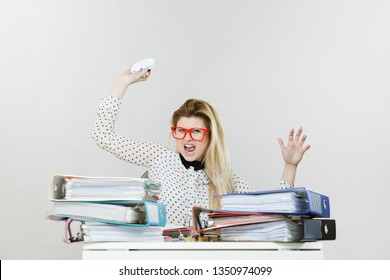 Mobbing at work, bad job relations concept. Angry mad bossy businesswoman being furious sitting working at desk throwing paper