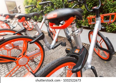 Mobike, Public bicycles parked in public area for tourists and people interested in borrowing to ride in the city and rent by QR code and mobile application technology. BANGKOK, THAILAND, Feb 22, 2018