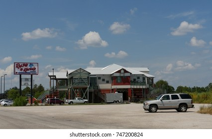 MOBILE, ALABAMA—AUGUST 2015:  Front  view of Ralph and Kacoo's, a popular seafood restaurant and favorite stopover of travelers in Mobile,Alabama.