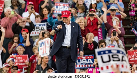 "Mobile, Alabama - 12/17/2016.   US President-elect Donald Trump points to the crowd during his ""Thank You Tour"" at Ladd-Peebles Stadium.  ""This is where it all started, remember that?"" Trump stated."