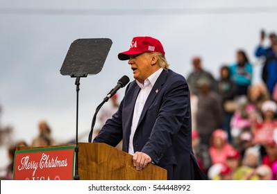 "Mobile, Alabama - 12/17/2016:  US President-elect Donald J. Trump speaks to the crowd during his ""Thank You Tour"" at Ladd-Peebles Stadium."