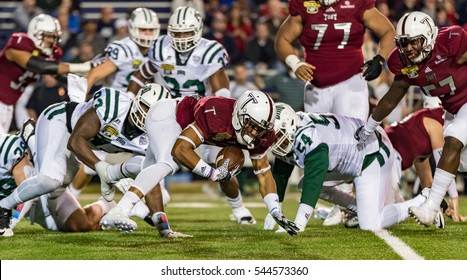 Mobile, Alabama - 12/23/2016:  Troy University #26 B.J. Smith recovers his own fumble after a kick-off from the Ohio Bobcats during the Dollar General Bowl at Ladd-Peebles Stadium.