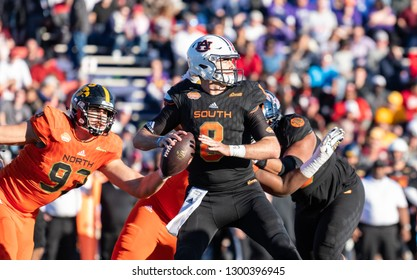 Mobile, Alabama / USA - 01/26/2019: Auburn QB (8) Jarrett Stidham is hit from behind by Iowa DE (93) Anthony Nelson during the 2019 Reese's Senior Bowl.  Resulting play is a fumble recovered by North.