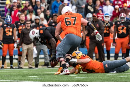 Mobile, Alabama, USA.  28th January, 2017:  North Team QB (4) Nate Peterman fumbles the ball after being hit by (1) Montravious Adams who recovers the fumble during the Reese's Senior Bowl.