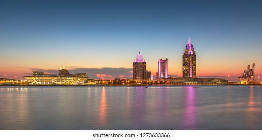 Mobile, Alabama, USA downtown skyline panorama on the river.