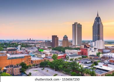 Mobile, Alabama, USA downtown skyline at dusk.