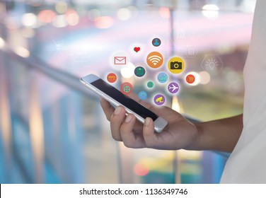 Mobile application concept.Man using touch screen smart phone