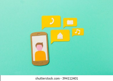 Mobile apps and communication - concept graphic made with paper cuts