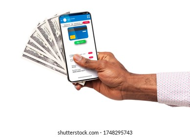 Mobile Banking. Black Male's Hand Holding Smartphone With Credit Card Holder Information And Dollar Cash, Closeup