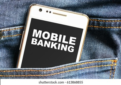 Mobile banking inscription on phone screen / Smartphone in front jeans pocket with Mobile banking inscription