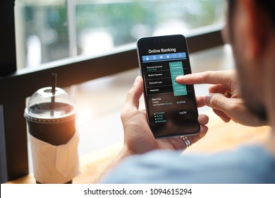 Mobile banking. Man using online banking technology on touch screen device. Financeial and investment. Digital and internet payments shopping on network connection. All on screen are design up.