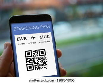 Mobile boardning pass in cell phone. Modern check in system for flight.