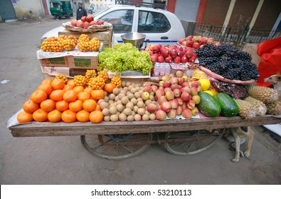 Mobile cart selling fruit on the street in Delhi, India.