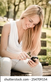 Mobile communication - smiling teenager