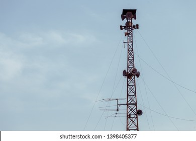 Mobile communications tower  with blue sky and white clouds.