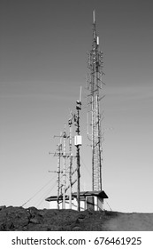 Mobile communications tower. Telecom infrastructure. Black and white style.
