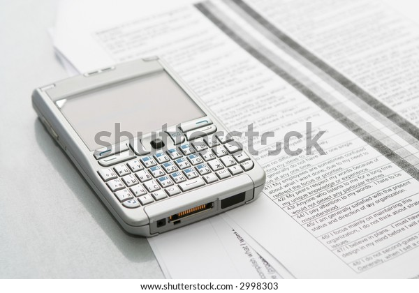 Mobile computer (organizer) on the documents at office table