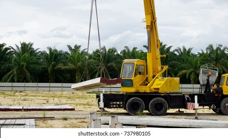 Mobile crane doing lifting operation of piling rod at construction site