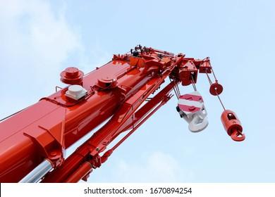 Mobile crane on blue sky background.