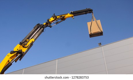 The mobile crane raises the load. They lift the air conditioner