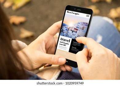 mobile design concept: woman holding a 3d generated smartphone with travel website on the screen. Graphics on screen are made up.