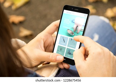 mobile design concept: woman holding a 3d generated smartphone with navigation app on the screen. Graphics on screen are made up.