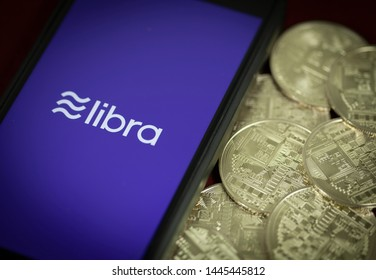 Mobile Device with Libra crypto currency symbol - online digital banking and payment concept