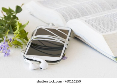 mobile and dictionary english for study on table white