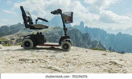 Mobile electric buggies on the mountain, Dolomites, Italy. Motorised wheelchair for disposable people, disable car