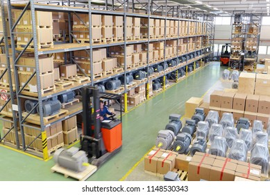 mobile forklift truck in the warehouse of an industrial company - storage of produced goods for dispatch to the customer