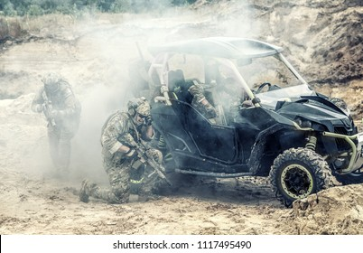 Mobile group of US commandos, special forces team on desert patrol vehicle fighting with enemy, covering position with smoke screen, calling for reinforcements while being under attack in sandy area