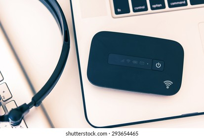 Mobile Hotspot Wi-Fi Device and Laptop Workstation. Cellular Broadband Technology. Internet On The Go.