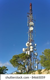 Mobile network communications tower with a lot of antennas