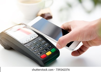 Mobile payment in cafe with smart phone nfc near field communication wireless technology