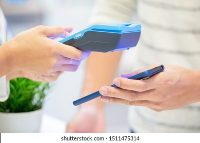 mobile payment concept - close up of pay bills by Phone to Credit Card System