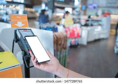 Mobile Payment concept,close up hand holding smart phone with white screen copy space for Advertising,Paying through terminal