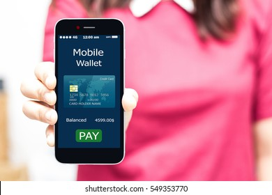 Mobile payment concept.Female hands holding smart phone,high key
