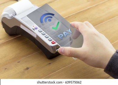 Mobile payments concept with EDC machine or credit card terminal with NFC contactless.
