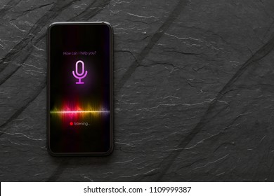 Mobile phone with activated voice assistant.