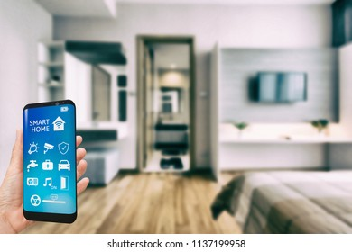 Mobile phone with app smart home intelligent house automation remote control technology concept