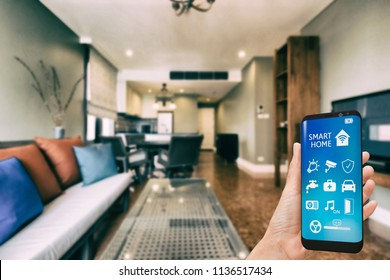 Mobile phone with app smarthome intelligent house automation remote control technology concept
