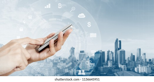 Mobile phone application and technology. Hand using mobile smart phone and city background