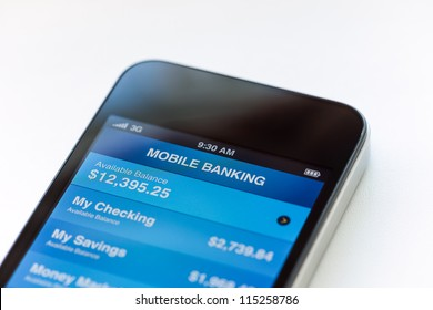 Mobile phone with mobile banking application on a screen. Closeup shot.