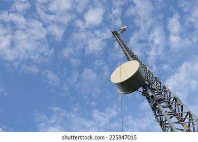 Mobile phone base station communications tower with blue sky