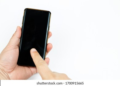 Mobile phone with black copy space screen in the hand with pointing finger