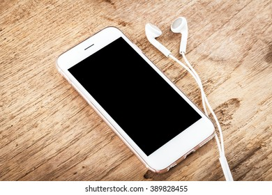 Mobile Phone With Blank Screen Mockup Isolated On Wood Table