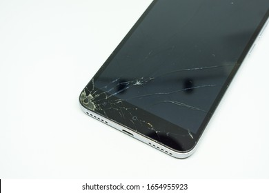 Mobile phone with broken screen isolated on white background. Smartphone with broken touch screen.