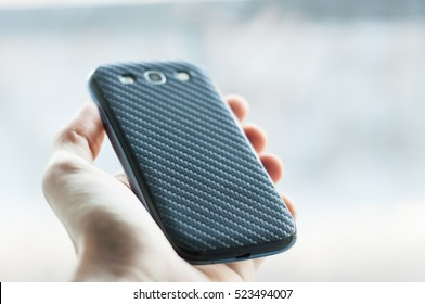 Mobile Phone with Carbon Back Cover
