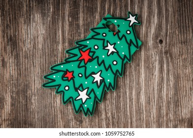 Mobile phone case in christmas tree shape over retro wood